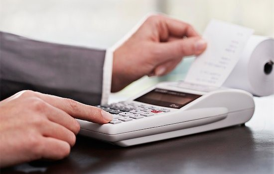 677-06012131 © Masterfile Royalty-Free Model Release: Yes Property Release: Yes Close up of businessman's hands counting on calculator