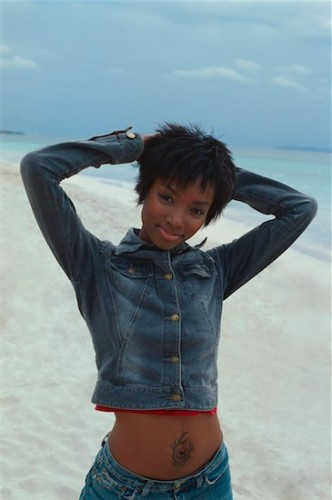 646-02072727 Model Release: Yes Property Release: No Portrait of young African-American woman at the beach