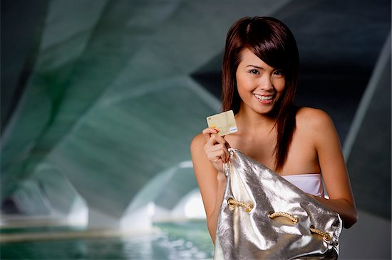 849-02877552 © Asia Images / Masterfile Model Release: Yes Property Release: No Woman holding gold credit card