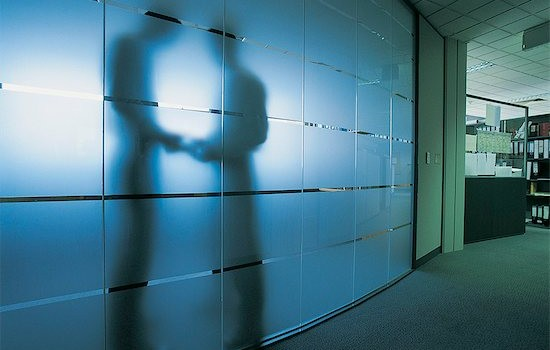 6106-06997448 © Masterfile Royalty-Free Model Release: Yes Property Release: Yes Silhouette of a Businessman Standing Behind a Frosted Glass Window in An Open Plan office Receiving a Bribe From Another Businessman