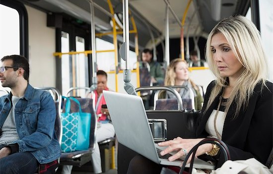 6117-08534834 © Masterfile Royalty-Free Model Release: Yes Property Release: Yes Businesswoman using laptop on bus