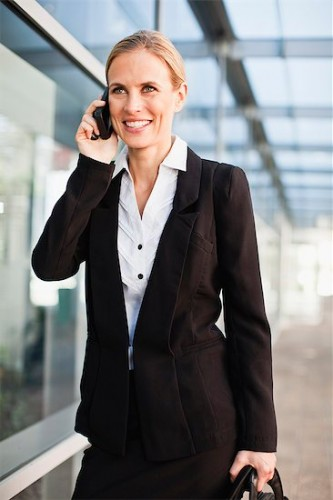 649-06717184 © Masterfile Royalty-Free Model Release: Yes Property Release: Yes Businesswoman talking on cell phone