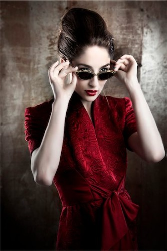 700-06145090 © Siephoto Model Release: Yes Property Release: No Portrait of Woman Wearing Red Dress and Sunglasses